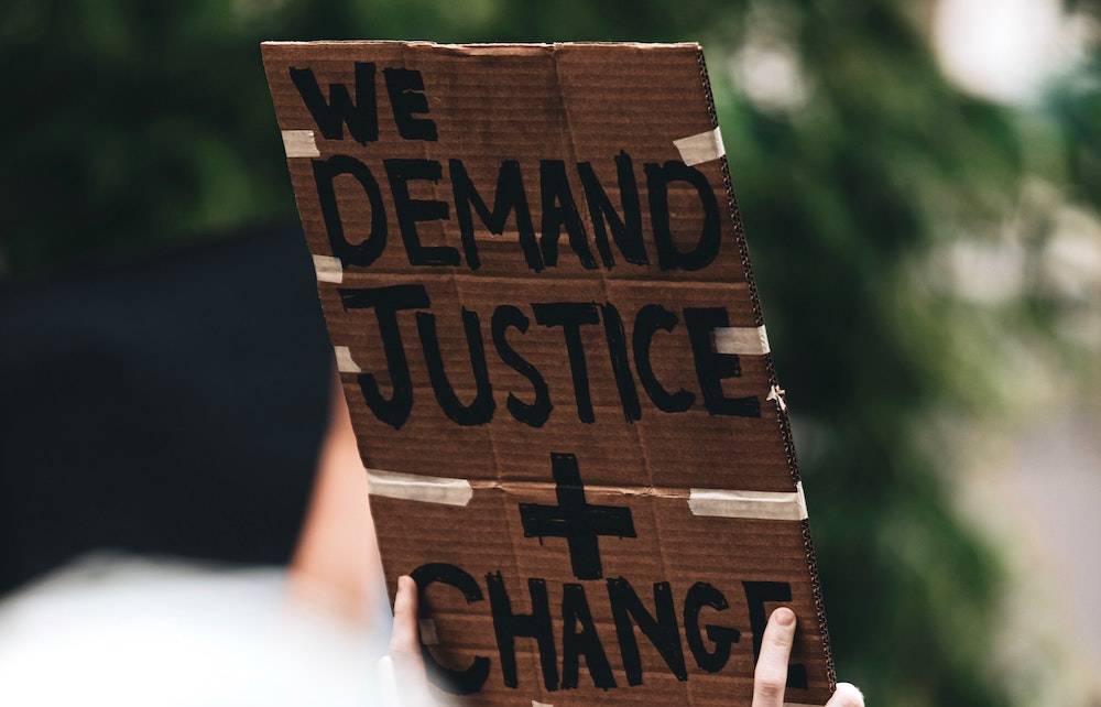 Protest sign for justice and change